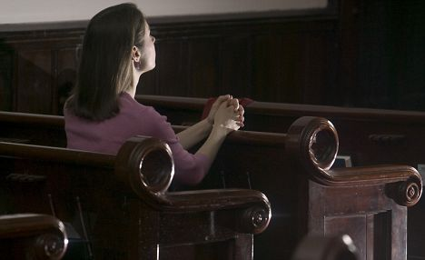 Woman Sitting in Pew