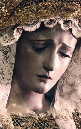 Junto a la cruz estaba su madre